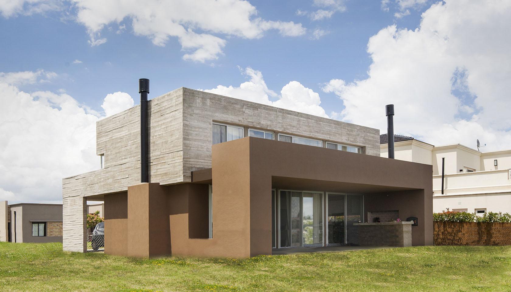 arquitectura minimalista, composición de volúmenes arquitectónicos, hormigón visto