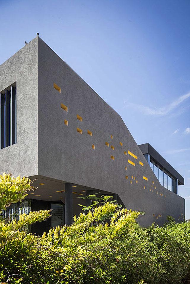 casas con diseños interesantes, plegados arquitectónicos, living en voladizo